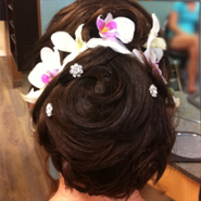 brunette updo with flowers